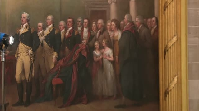 vídeos de stock e filmes b-roll de slow pan out from a mural in the capitol rotunda entitled general george washington resigning his commission to the floor prior to a memorial service... - george washington