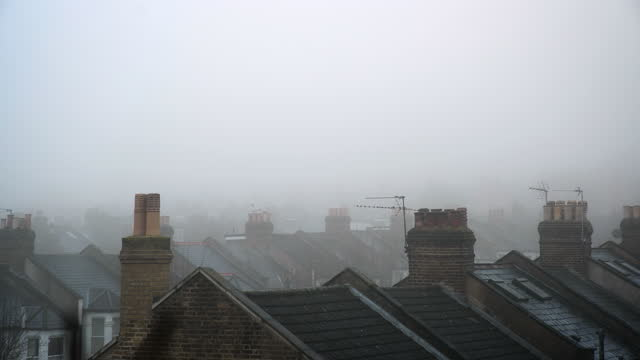 slow pan over rooftops in fog, london - cold temperature stock videos & royalty-free footage