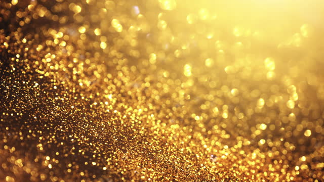 slow particle stream - macro shot - gold colored, christmas, celebration - abstract background - loopable - gold medalist stock videos & royalty-free footage