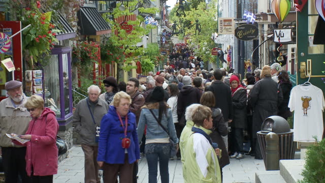 slow pull back of crowds in champlain street - quebec stock videos and b-roll footage