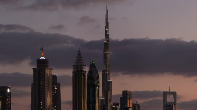 slow pullback from burj khalifa - tall high stock videos & royalty-free footage