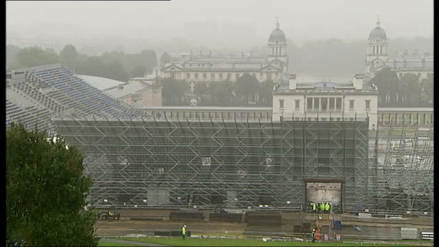 slow restoration of greenwich park following london 2012 digger behind fence with 'pedestrian walkway' sign grass cutter vehcile towards workers... - royal navy college greenwich stock videos & royalty-free footage