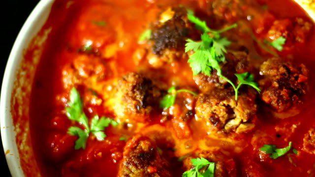 slow simmering meatball and sauce meal. - routine stock videos & royalty-free footage