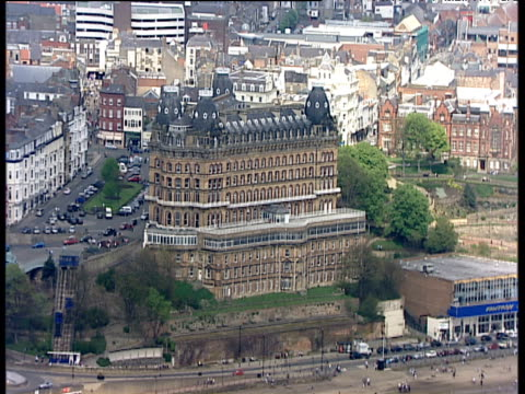 slow track backwards from scarborough grand hotel on seafront - scarborough inghliterra video stock e b–roll