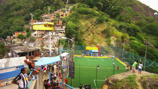 vidéos et rushes de rio de janeiro, brazil - june 23: slow tracking down a flight of stairs of soccer game in a favela - brésil