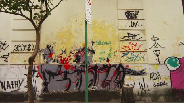 rio de janeiro, brazil - june 23: slow tracking down a street of rio de janeiro with graffiti - favela stock videos and b-roll footage