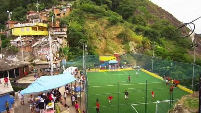 RIO DE JANEIRO, BRAZIL - JUNE 23: Slow tracking on balcony of soccer fans sitting on a railing