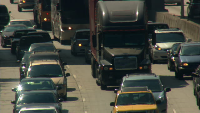 cu ha slow traffic on multiple lane highway, los angeles, california, usa - queuing stock videos & royalty-free footage