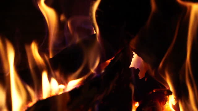 slow video of the detail of active fire in a fireplace - 可燃性点の映像素材/bロール