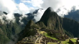 slow zoom in of machu picchu on a misty morning