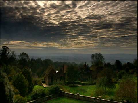 slow zoom in to chartwell house and gardens with mackerel sky above kent - grounds stock videos & royalty-free footage