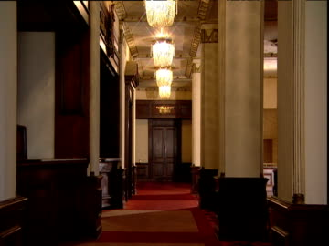 vídeos y material grabado en eventos de stock de slow zoom into doors leading to cocoanut grove location of the third academy awards from interior of ambassador hotel hollywood - hotel de lujo