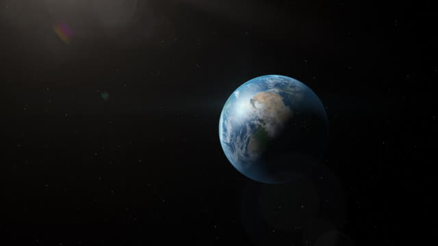 gfx slow zoom into rotating planet earth - digital animation stock videos & royalty-free footage