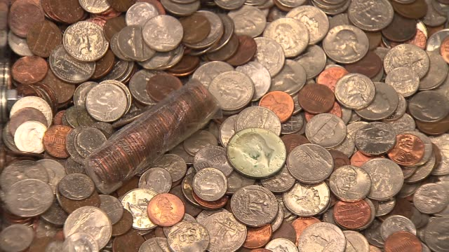 Slow zoom onto pile of coins