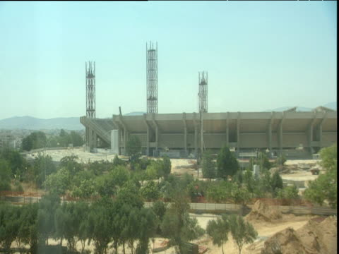 slow zoom out on olympic stadium for 2004 olympic games athens - erezione video stock e b–roll