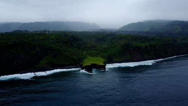 slowly approaching maui island and peninsula extending into ocean - peninsula stock videos and b-roll footage