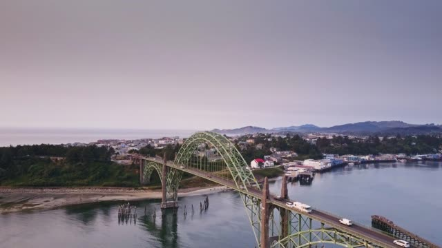 slowly climbing drone shot of yaquina bay bridge, oregon - 1936 stock videos & royalty-free footage