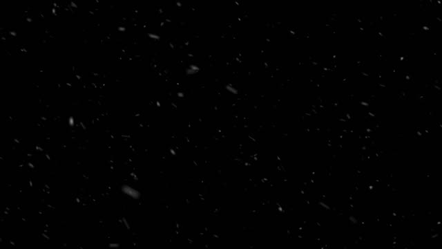 slowly falling snow on black background - snowing stock videos & royalty-free footage