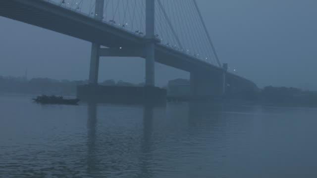 slowly passing by howrah bridge in kolkata by boat - howrah bridge stock videos & royalty-free footage