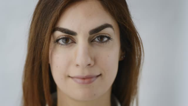 slowly walking in to focus. close up portrait of young modern middle east woman, looking straight in the camera. shot with a tilt shift lens. - middle eastern ethnicity stock videos & royalty-free footage