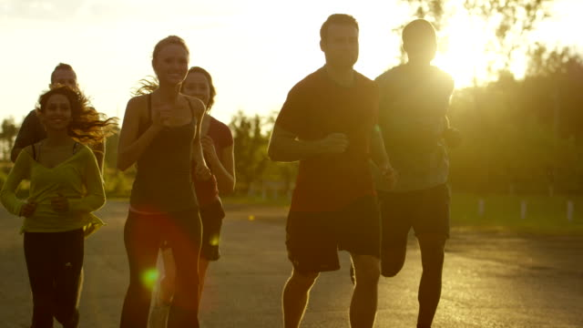 hd slow-mo: group running - jogging stock videos & royalty-free footage