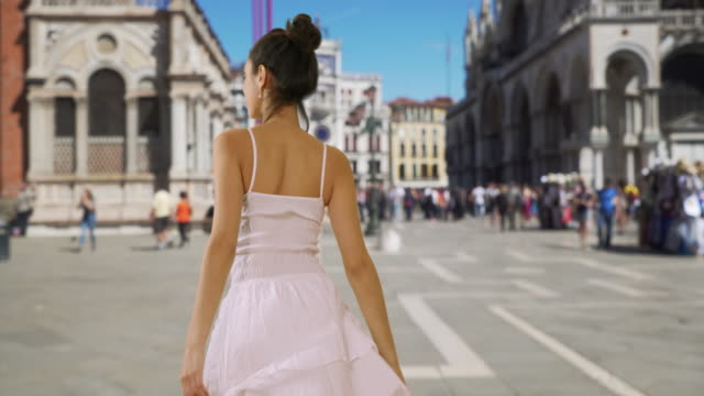 slow-mo of beautiful hispanic female in sundress dancing in st. mark's square - sundress stock videos & royalty-free footage