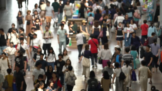slowmotion: abstract blurred background top view tourist pedestrian crowded at motomachi shopping street kobe japan - walkable city stock videos & royalty-free footage