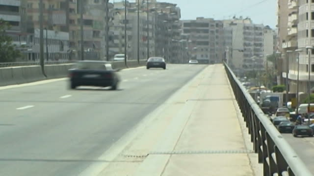 slowmotion clip of traffic on dahieh bridge the area is the beirut stronghold of the shiite islamist group hezbollah - shi'ite islam stock videos & royalty-free footage