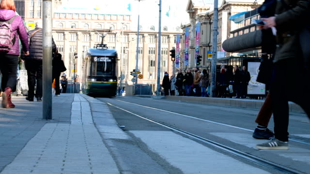slowmotion close up at foot : routine life of european people waiting for city tram car at bus stop. - tram stock videos & royalty-free footage