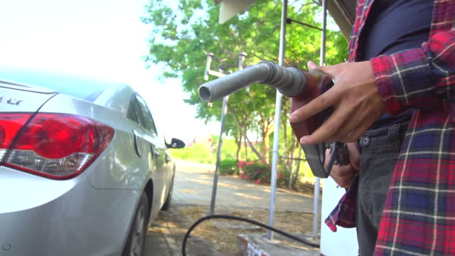 slowmotion: gasoline droplet dripping from gas spout - fuel pump stock videos and b-roll footage
