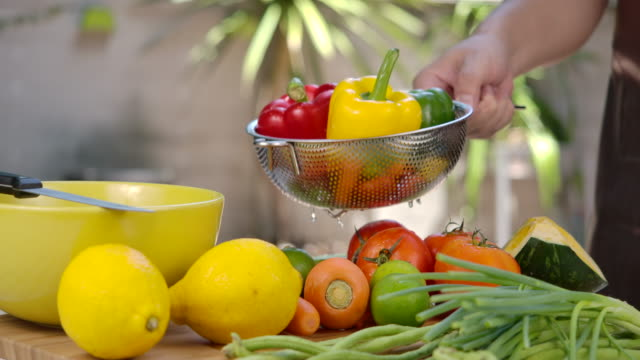 slow-motion he is washing fruits and vegetables. - carrot stock videos & royalty-free footage