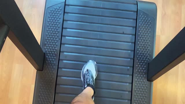 slow-motion of man running on treadmill cardio equipment. - cardiovascular exercise stock videos & royalty-free footage