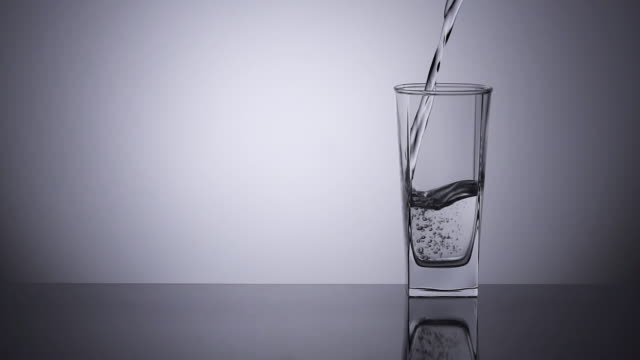 Slow-motion, Pouring water into a drinking glass.