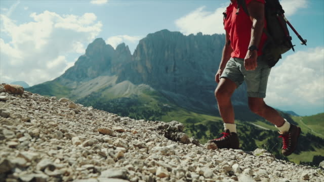 slow-motion senior man trail hiking on high mountain - sentiero video stock e b–roll