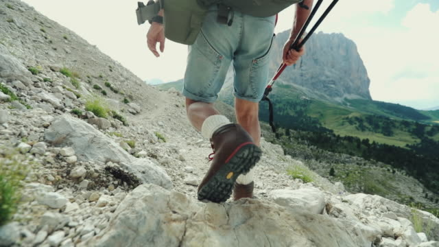 slow-motion senior man trail hiking on mountain - behind stock videos & royalty-free footage