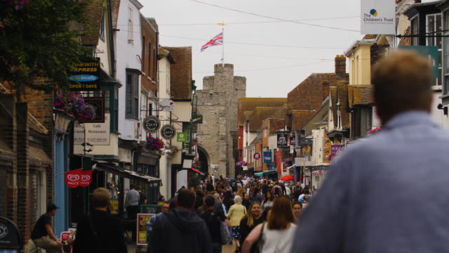 Slow-motion shot of a busy Canterbury High Street leading to Westgate, Kent, UK.