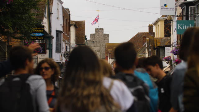 Slow-motion shot of a tour group standing in Canterbury's High Street, Kent, UK.