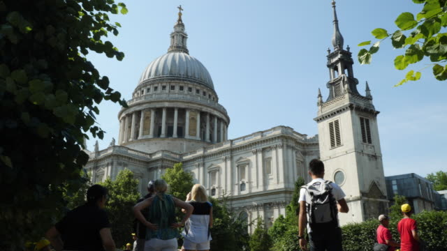 Slow-motion shot of people walking towards St Paul's Cathedral, London, UK.