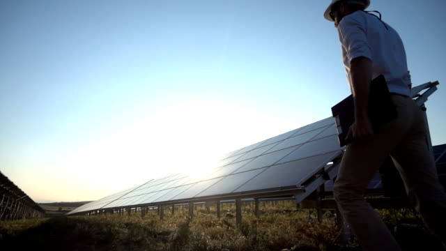 slowmotion technician at solar power station - solar power station stock videos and b-roll footage