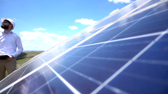 Slowmotion Technician At Solar Power Station