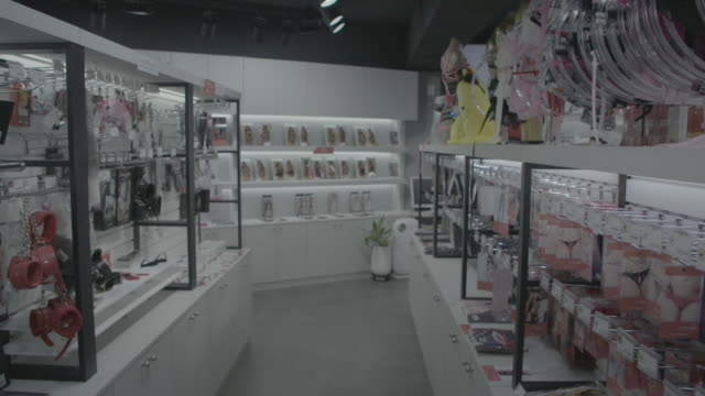 slow-motion through sex shop aisle of toys in seoul - sex toy stock videos and b-roll footage