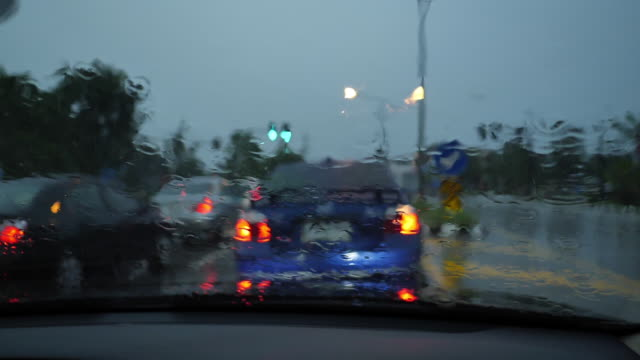 slow-motion, traffic jam in the rainy day - green light stoplight stock videos and b-roll footage