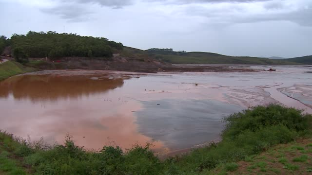 sludge and mining waste at iron ore tailings maravilhas il dam at itabirito in minas gerais brazil - iron ore stock videos & royalty-free footage
