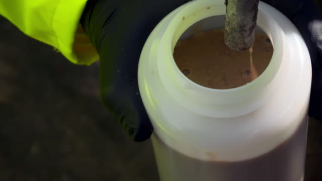 sludgy liquid is produced at a food recycling plant - slimy stock videos & royalty-free footage