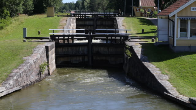 sluice in the göta channel in sweden near gothenburg - canal stock videos & royalty-free footage