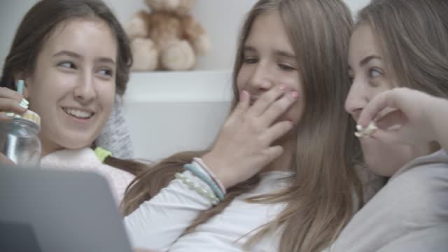 4k: slumber fun time with laptop. - slumber party stock videos & royalty-free footage