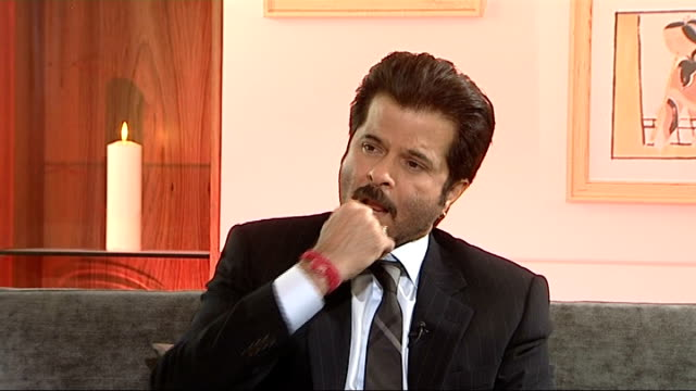 'slumdog millionaire': anil kapoor interview; - how he feels about the reaction to the film - positive and negative / it's an indian film, not a... - film negative stock videos & royalty-free footage