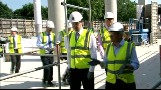 GDP slumps as UK recession deepens George Osborne MP visiting Crick Institute construction site / building site with others HMS Ocean David Cameron...