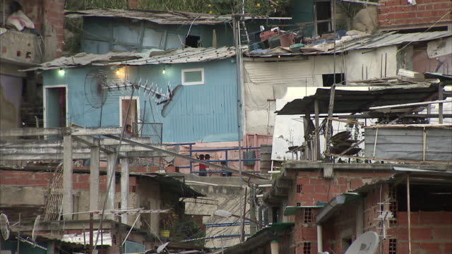 ms tu pan slums buildings on mountainside in petare / caracas, miranda, venezuela - venezuela stock videos & royalty-free footage