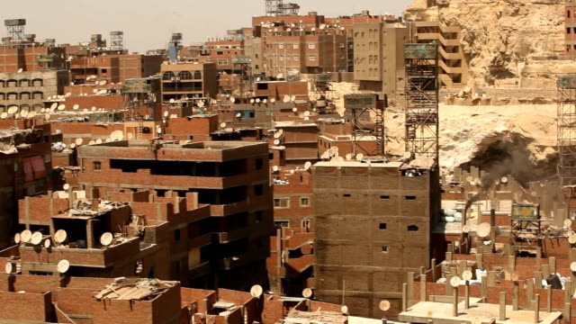 ms tilt slums of cairo with smoke/ cairo / egypt - egypt stock videos & royalty-free footage